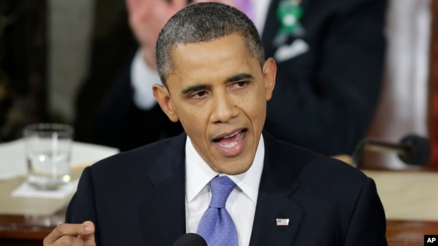President Barack Obama gestures as he gives his State of the Union address during a joint session of Congress on Capitol Hill in Washington, Feb. 12, 2013