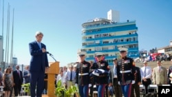 Secretary of State John Kerry watches as U.S. Marines, stationed in Cuba carry the American flag during the raising of the U.S. flag over the newly reopened embassy in Havana, Cuba. Aug. 14, 2015.