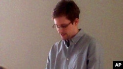 This handout file photo taken on Friday, July 12, 2013, and made available by Human Rights Watch, shows NSA leaker Edward Snowden during his meeting with Russian activists at Moscow airport.