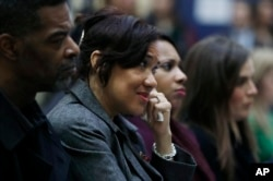 Flint Mayor Karen Weaver listens as Michigan Attorney General Bill Schuette addresses a news conference, Dec. 20, 2016 in Flint, Michigan.
