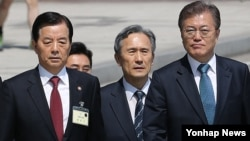 "South Korean President Moon Jae-in (right) appears with former presidential security adviser Kim Kwan-jin (center) and defense minister Han Min Goo (right). Moon called on North Korea to stop ""provocations"" with its missile and nuclear program. He also moved to delay deployment of the American anti-missile system known as THAAD."