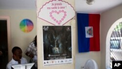A Massimadi festival poster hangs at the Kouraj organization office in Port-au-Prince, Haiti, Sept. 27, 2016.