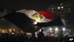 Egyptians celebrate the victory of Mohammed Morsi in Tahrir Square, Cairo, Egypt, Monday, June 25, 2012. The Muslim Brotherhood's Mohammed Morsi was declared the winner of Egypt's first free presidential election Sunday, and he proclaimed himself a leader