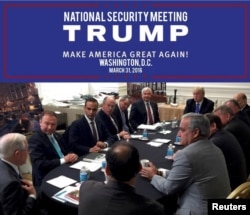 George Papadopoulos (3rd L) appears in a photograph released on Donald Trump's social media accounts with a headline stating that the scene was of his campaign's national security meeting in Washington, D.C., on March 31, 2016 and published April 1, 2016.
