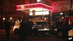 纽约星期三发生枪击案后,调查人员赶到现场。