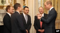 On Oct. 16, 2018, Prince William, right, hosts a reception at Buckingham Palace to recognize the extraordinary contribution made by British rescue divers and support staff in the rescue of 12 boys and their soccerl coach from the Tham Luang Cave in Thailand.