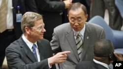 German Foreign Minister Guido Westerwelle speaks with U.N. Secretary-General Ban Ki-moon before a Security Council meeting on Children and Armed Conflict at the UN headquarters in New York, July 12, 2011