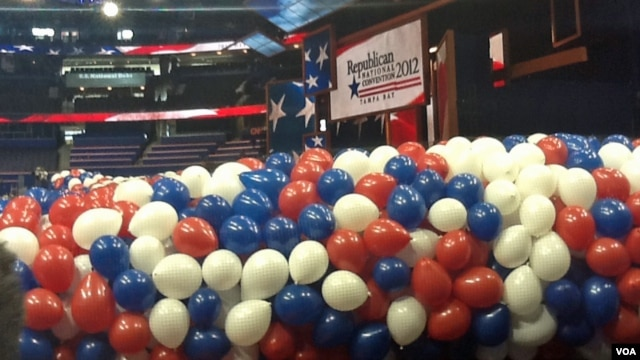 "Red, white and blue balloons bundled up before being lifted to the ceiling of the Tampa Bay Times Forum for the traditional ""balloon drop"" on the final convention night."
