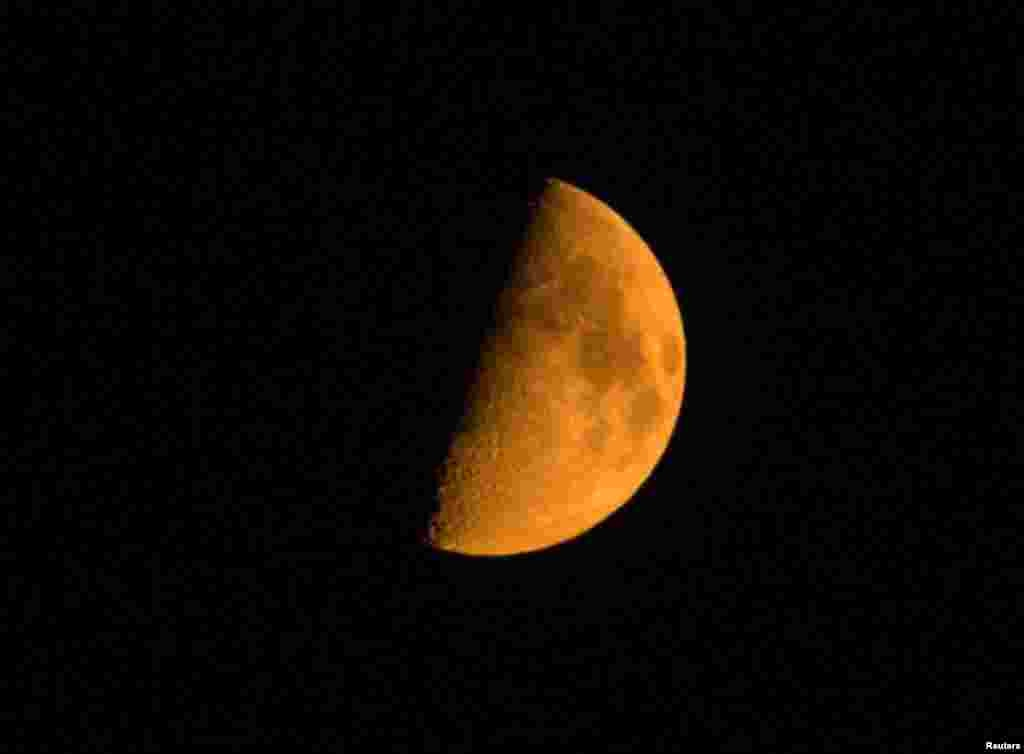 The moon as pictured through smoke from the Chelan Complex fire in Manson, Washington, Aug. 22, 2015.