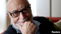 Belgian physicist Francois Englert poses in his home in Brussels, Oct. 8, 2012.