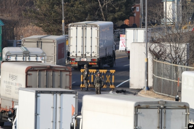 FILE - South Korean cargo trucks head to the North Korean city of Kaesong as South Korean Army soldiers stand guard at the customs, immigration and quarantine office near the border village of Panmunjom in Paju, South Korea, Feb. 11, 2016.