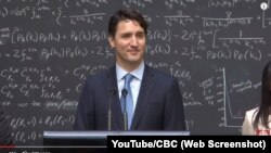 Canadian Prime Minister Justin Trudeau speaks with reporters about quantum computing during an event at a physics research lab in Ontario in April 2016.