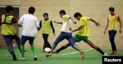 Asylum seekers take part in a soccer training session in Vienna, Austria, September 25, 2015. Austrian top league soccer club FK Austria Wien provides facilities and professional coaches to migrants for recreation and talent seeking.