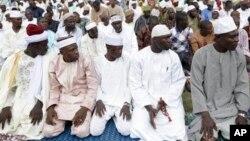 Muslim youths praying