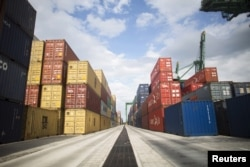 FILE - Containers line the Mariel port near Havana, Cuba. U.S. export industries could benefit from access to shipping lanes and ports, the Engage Cuba coalition said in 2015. It's pressing for stronger U.S.-Cuba connections.