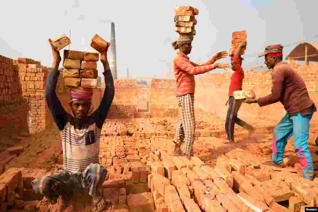 Laborers work in a brick kiln in Narayanganj, Bangladesh.