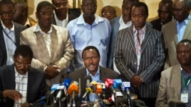 Kalonzo Musyoka, center, Kenya's current Vice President and running mate of presidential candidate Raila Odinga, speaks at a press conference in Nairobi, Kenya, Mar. 7, 2013.