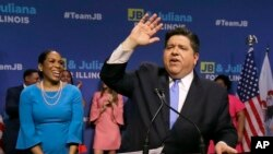 Democratic gubernatorial candidate J.B. Pritzker, right, celebrates winning the Democratic gubernatorial primary with lieutenant governor candidate Juliana Stratton, March 20, 2018, in Chicago.