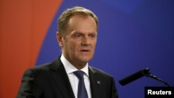 European Council President Donald Tusk addresses a joint press conference at the end of the Valletta Summit on Migration in Valletta, Malta, Nov. 12, 2015.