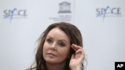 British soprano singer Sarah Brightman listens journalists during news conference in Moscow, Russia, Oct. 10, 2012 to announce that she will become the first-ever global recording artist to take a spaceflight, teaming up with Space Adventures for a journe