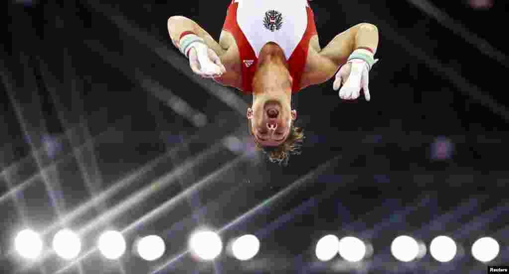 Fabian Leimlehner of Austria competes on the horizontal bar during the men's gymnastics team event at the 1st European Games in Baku, Azerbaijan.