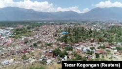 Uharibifu uliyoletwa na tetemeko la ardhi na wimbi kubwa la tsunami huko Palu, Jimbo la Sulawesi la kati, Indonesia, Septemba 30, 2018.