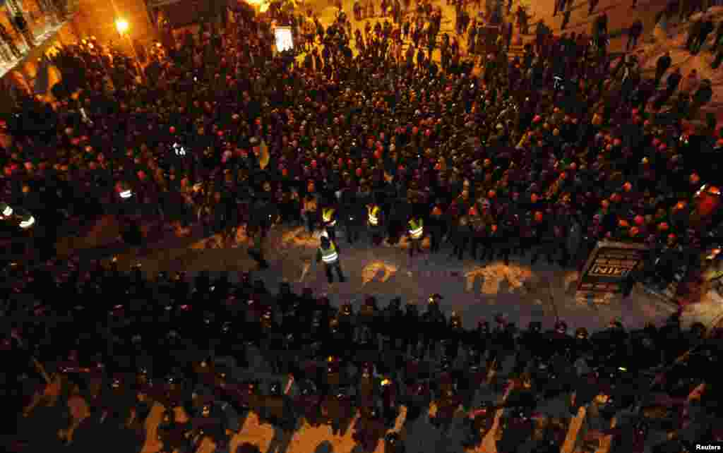 Pro-European integration protesters line up in front of riot police in Kyiv, Dec. 11, 2013.