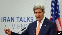 U.S. Secretary of State John Kerry speaking to the media after closed-door nuclear talks on Iran in Vienna, Austria, July 15, 2014.