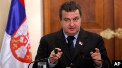 Serbia's Prime Minister Ivica Dacic gestures as speaks to the media during a press conference after meeting with Cyprus' president Dimitris Christofias, unseen, at presidential palace in divided capital Nicosia, Friday, Dec. 7, 2012. Dacic said talks for