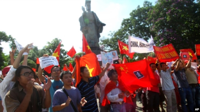 Hundreds of Vietnamese hold a rare protest in Hanoi demanding China stay out of their country's waters Sunday, June 5, 2011.