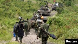 FILE - Congolese soldiers move to front line positions as they advance against the M23 rebels in Kibumba, north of Goma, Oct. 27, 2013.