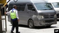An unidentified van believed to be carrying the body of Kim Jong Nam comes out from the forensic department at Kuala Lumpur Hospital in Kuala Lumpur, Malaysia, March 30, 2017.