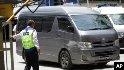 FILE - An unidentified van believed to be carrying the body of Kim Jong Nam comes out from the forensic department at Kuala Lumpur Hospital in Kuala Lumpur, Malaysia, March 30, 2017.