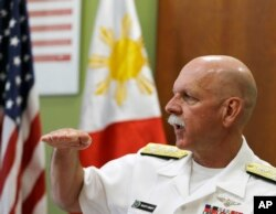 FILE - U.S. Pacific Fleet Commander Adm. Scott Swift gestures during an interview with journalists July 17, 2015 in Manila, Philippines.