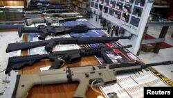 FILE - Guns for sale are displayed at Roseburg Gun Shop in Roseburg, Oregon, Oct. 3, 2015.