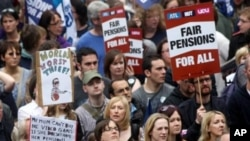 Union members are seen during a mass group gathering in Newcastle, England, June 30, 2011,as thousands of public service workers and teachers in Britain go on strike over pension and government cuts
