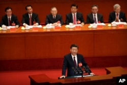 Chinese President Xi Jinping delivers a speech during the opening session of China's 19th Party Congress at the Great Hall of the People in Beijing, Wednesday, Oct. 18, 2017.