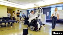 Paralyzed patient steers a wheelchair using his tongue. Perhaps in the not-too-distant future he will be able to drive it using his thoughts.