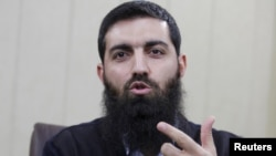 FILE- Halis Bayancuk, a Turkish cleric detained several times on suspicion of aiding al-Qaida, in Istanbul, Turkey, March 22, 2015. Bayancuk, 31, also known as Abu Hanzala, has cautioned Ankara against taking a more active role in the U.S.-led fight again