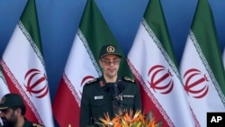 FILE - In this Sept. 21, 2016 file photo, Chief of Staff of Iran's Armed Forces, General Mohammad Hossein Bagheri delivers a speech during a military parade. On May 8, 2017, Bagheri was quoted as saying soldiers will attack terrorists wherever they are, suggesting they could go over the border into Pakistan to target militants there. The report comes after an attack claimed by the Sunni militant group Jaish-ul-Adl killed 10 soldiers in April.