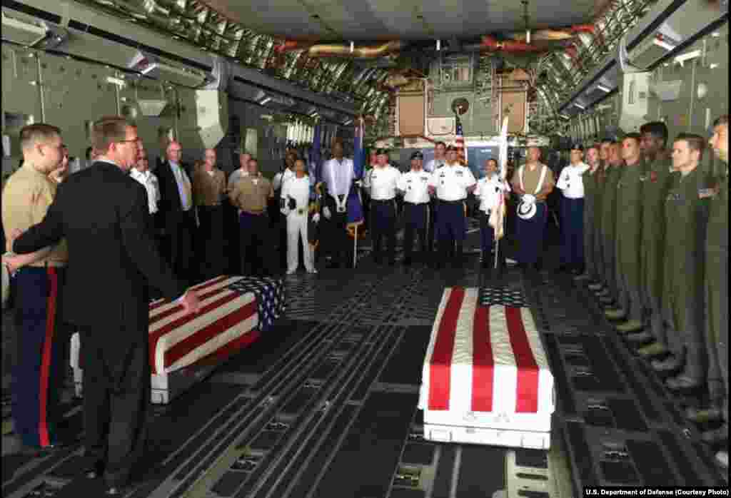 U.S. Defense Secretary Ash Carter, second left, with U.S. military members after they loaded the casket of what could be the remains of one to two crew members from a World War Two crash, in a C-17 aircraft, at Palam airport, in New Delhi, India, April 13
