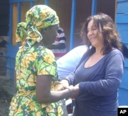 Picture here in Goma, FXBVillage founder Albina du Boisrouvray meets with a woman benefiting from the aid program. (AP PHOTO)