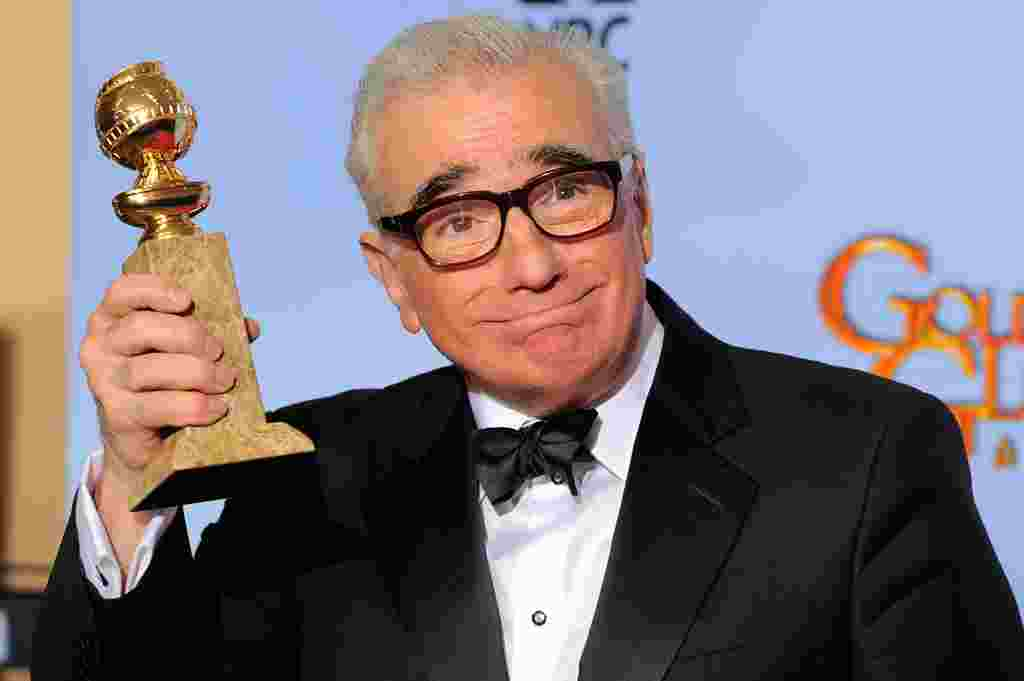 "Director Martin Scorsese poses backstage with the award for Best Director of a Motion Picture for the film ""Hugo"" during the 69th Annual Golden Globe Awards January 15, 2012, in Los Angeles. (AP)"