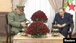 FILE - Algeria's President Abdelaziz Bouteflika, right, meets with Army Chief of Staff Lieutenant General Ahmed Gaid Salah in Algiers, Algeria, in this handout still image taken from a TV footage released on March 11, 2019.