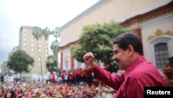 Venezuela's President Nicolas Maduro gestures as he arrives for a rally with supporters in Caracas, Nov. 7, 2017.