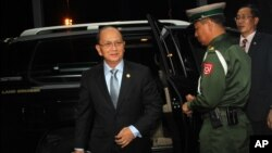 FILE - Burmese president Thein Sein prepares to leave for a state visit to the U.S., at Rangoon International airport, Burma, May 17, 2013.