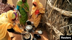 Women cook on a stove made out of mud at a women development program center funded by the WFP in North Darfur. (File)