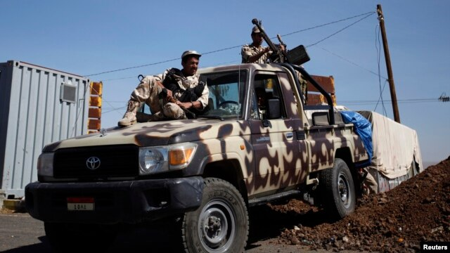 FILE - Army soldiers are seen at a checkpoint outside Amran city, the capital of Amran province, north of Sanaa, amid tension with militants of the Shi'ite Houthi group, Apr. 13, 2014.
