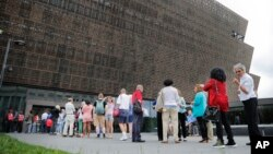 FILE - People wait in line to enter the Smithsonian National Museum of African American History and Cultural on the National Mall in Washington, May 1, 2017. On Wednesday, a noose, a symbol of racism in the U.S., was found on Smithsonian grounds, the second such incident this week.