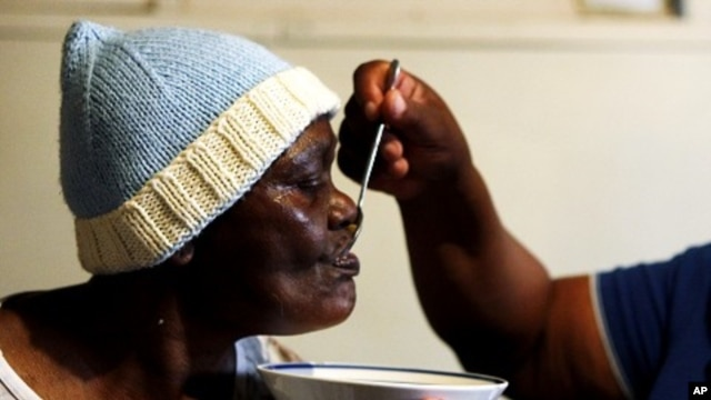 An AIDS patient is fed by a volunteer worker of the Sakhi-Sizwe AIDS care initiative in Orange Farm township, south of Johannesburg (file photo)